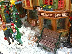 View of bench and street next to the Lemax Cheese and Wine Shop