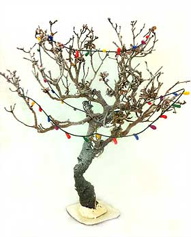 Photo of model tree, decorated with a string of fairy lights made from Fimo clay