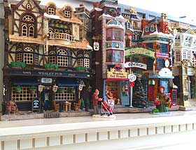 Close-up view of a miniature Christmas Village, using facade buildings from Lemax