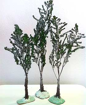 Picture of model trees made from dried astilbe flowers, sprayed green