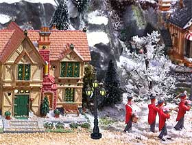 Close-up image of Lemax marching band figurines and Caddington Village house