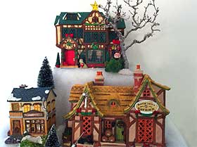Picture of Lemax Christmas buildings, including the Haypenny Tavern and Decorating the House