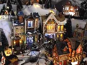 Further view of the Christmas village buildings lit at night