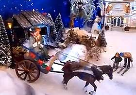 Photo of miniature horse and carriage, in the Christmas snow