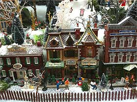 photograph showing model picket fencing in front of lemax facade houses - Miniature Christmas Village