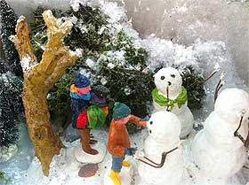 Picture of reindeer moss next to the Lemax snowmen model named Building a Family