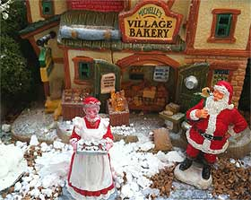 Mrs Claus pictured emerging from the village bakery with a tray of gingerbread men