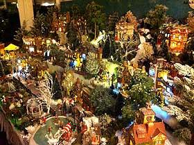 Night-time view of the completed Christmas Village display stand