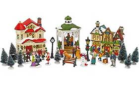 Photo of Christmas houses, trees and figures, sold as one starter set
