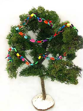 Photo of a model 'Holm oak' tree, decorated with miniature dolls house paper chain