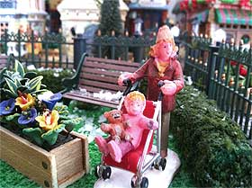 Picture of a Lemax figurine with pushchair