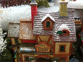 Photo of the Lemax Michelle's Village Bakery, with a snow-covered rooftop