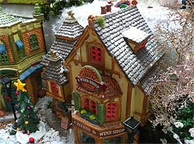 Image of the Lemax Hill of Beans Coffee Shop, with snowflakes sprinkled on the roof