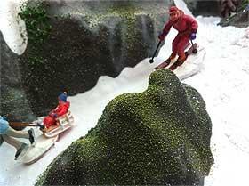 Image of figurine skiers