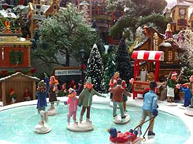 Picture of ice skaters on the Lemax Christmas Skating Pond