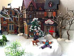Photo of the Lemax Sown Angel in a landscaped Christmas Village setting