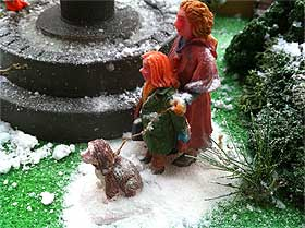 Image of Lemax figurines with their base covered in Scenic Snowflakes