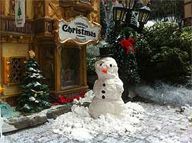 Image of miniature snowman in front of Lemax Tannenbaum Christmas Shoppe