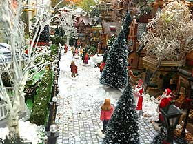 View down the shopping street, with model Christmas trees and snowflakes sprinkled liberally