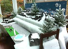 Further view of the table stand, with snow fabric and mountains added