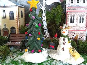 Photo of a pretty model Fimo Christmas tree and Lemax snowman