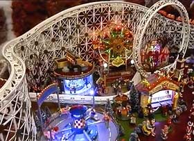 Image showing Christmas Village fairground, complete with model rollercoaster