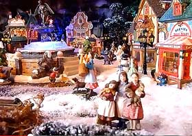 Photo of landscaped Christmas village, with figurines in the foreground
