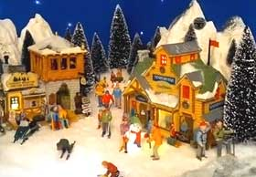 Picture of miniature Christmas Village display, with snow, Lemax houses and figurines