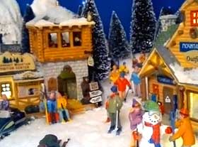 Image of model village, with snow and Lemax figures