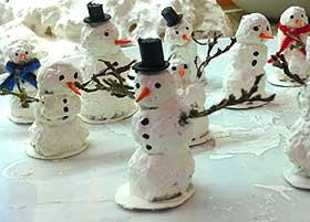 Picture of completed model snowmen, with scarves and top hats