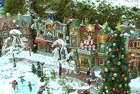 Picture of the park, dressed in snow and home to a tall Lemax Christmas tree