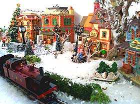 Picture of train running through miniature Christmas Village