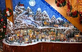 Photograph of a Christmas layout displayed beneath the stairs