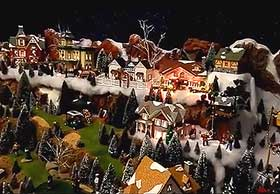 Model village photograph, with Christmas houses and dark sky backdrop
