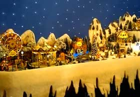 Photo of icicle edging fronting a lengthy Christmas village arrangement