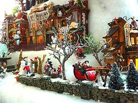 Picture of Christmas Village figurines, sledge and stone wall