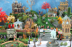 Photo showing a model Halloween village display, with miniature buildings and figurines