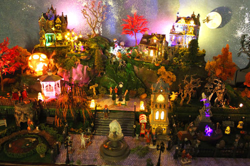 Photo of the same Halloween diorama at night, with coloured lighting