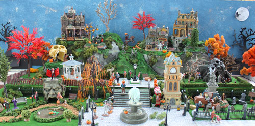 View of a Halloween village with the Christmas Lemax clock tower