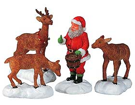 Photo of Lemax model Santa Claus feeding his reindeer