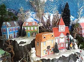 Side view of the miniature cardboard house Christmas village